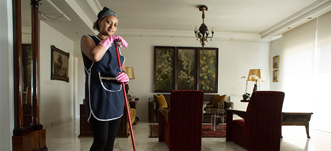 Domestic worker in Lebanon cleaning her employer's house