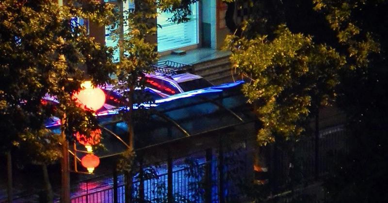 Red lanterns hang from street lights on Tuanjie Lu (Timothy Grose)